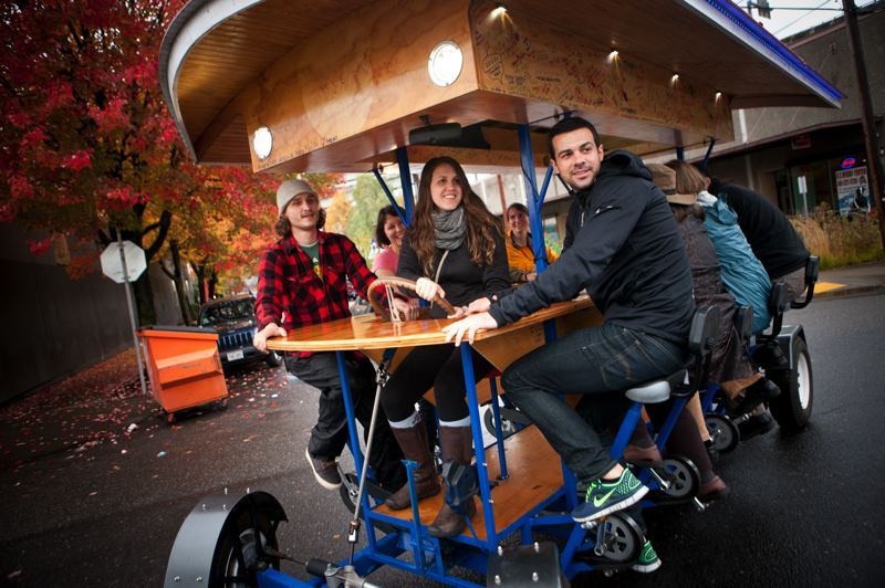 by: TRIBUNE PHOTO: CHRISTOPHER ONSTOTT - Eight BrewCycle pedalers, with Andrea Lins steering, ferry around the Pearl District from brewpub to brewpub. Not a bad way to make a living.