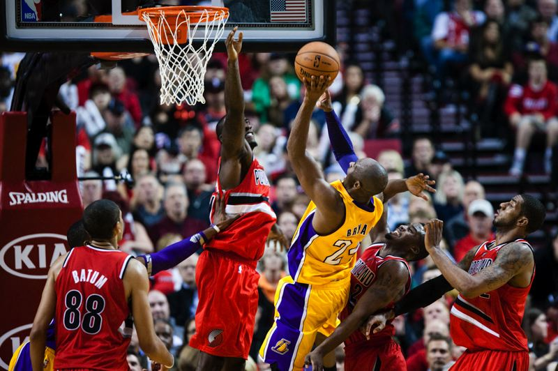 by: TRIBUNE PHOTO: CHRISTOPHER ONSTOTT - The Trail Blazers' defense converges around Los Angeles Lakers star Kobe Bryant as he tries to go to the basket at the Rose Garden. The Blazers beat L.A. 116-106 on Wednesday in Portland's season opener. The Lakers fell to 0-2.