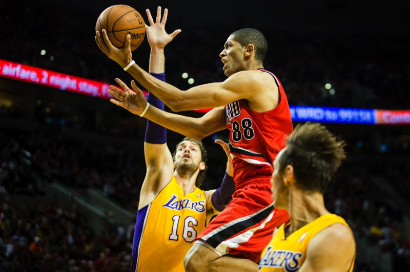 by: TRIBUNE PHOTO: CHRISTOPHER ONSTOTT - Portland forward Nicolas Batum finds a path through the Los Angeles Lakers' defense.