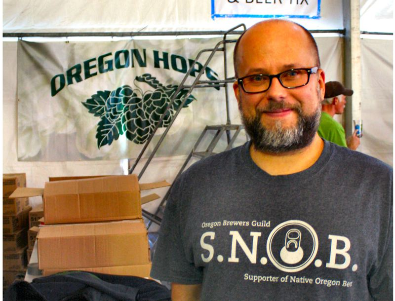 by: PETER KORCHNAK - Oregon Brewers Guild Executive Director Brian Butenschoen at this year's Fresh Hop Beer Fest at Oaks Park.