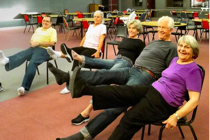 by: COURTESY OF LISA REVELL - In a Body Recall class in Sellwood, Paul Reynolds, Ina Hammond, Trish Goldman, Richard Poulton and Virginia Davenport pose to demonstrate an exercise designed to strengthen thigh and abdominal muscles.