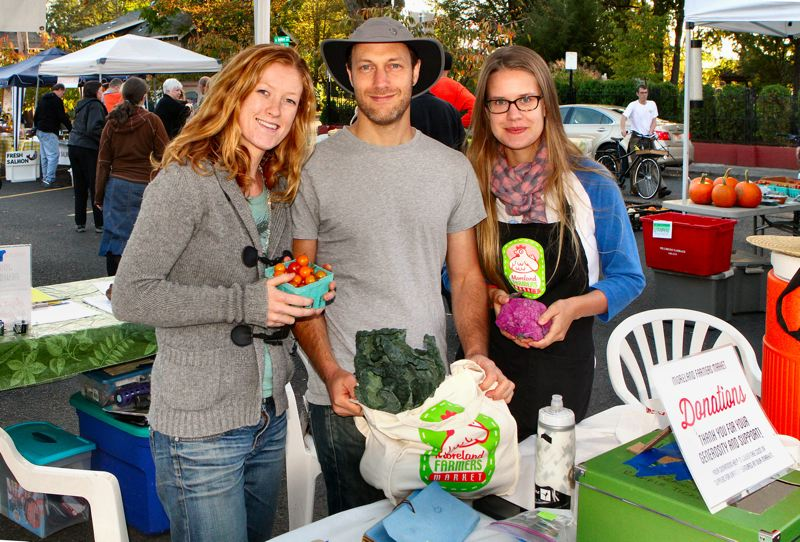by: DAVID F. ASHTON - Volunteer Zoe Flanagan and Kristen Eberlin flank Market Manager Adam Seidman, on the 2012 season's last day for the Moreland Farmers Market.