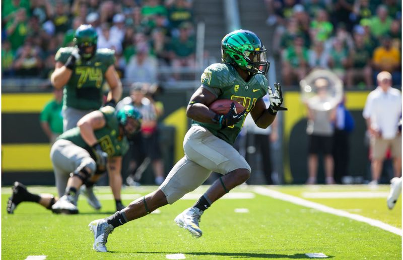 by: TRIBUNE PHOTO: CHRISTOPHER ONSTOTT - Kenjon Barner has rushed into potential Heisman Trophy talk this season as the Oregon Ducks' featured running back.