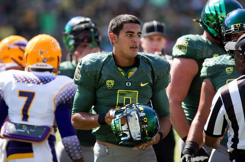 by: TRIBUNE PHOTO: CHRISTOPHER ONSTOTT - University of Oregon freshman quarterback Marcus Mariota is 'calm, cool and collected,' 'good for the team.'