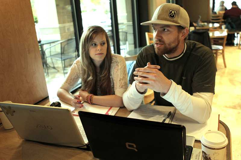 by: JAIME VALDEZ - While studying at Ava Roasteria on Tuesday afternoon, college students Elizabeth Eldred and her friend Evan Eldridge say they're keeping this year's presidential election at arm's length while they focus on school.