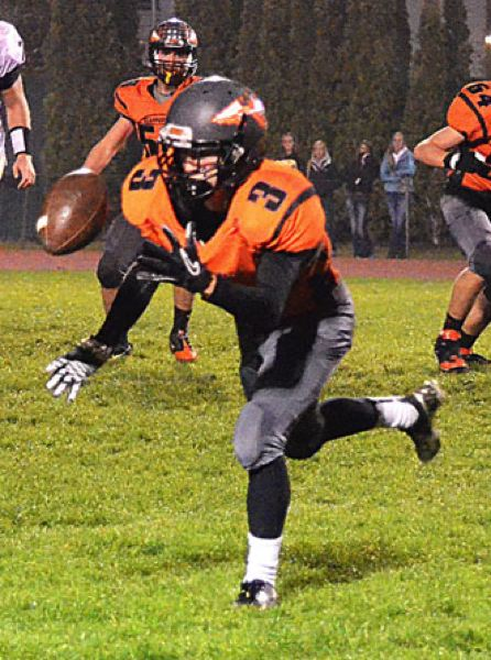 by: JOHN BREWINGTON - Scappoose's Kyle Kramer hauled in this pass from Taylor Loss for a first down in last Friday's game.
