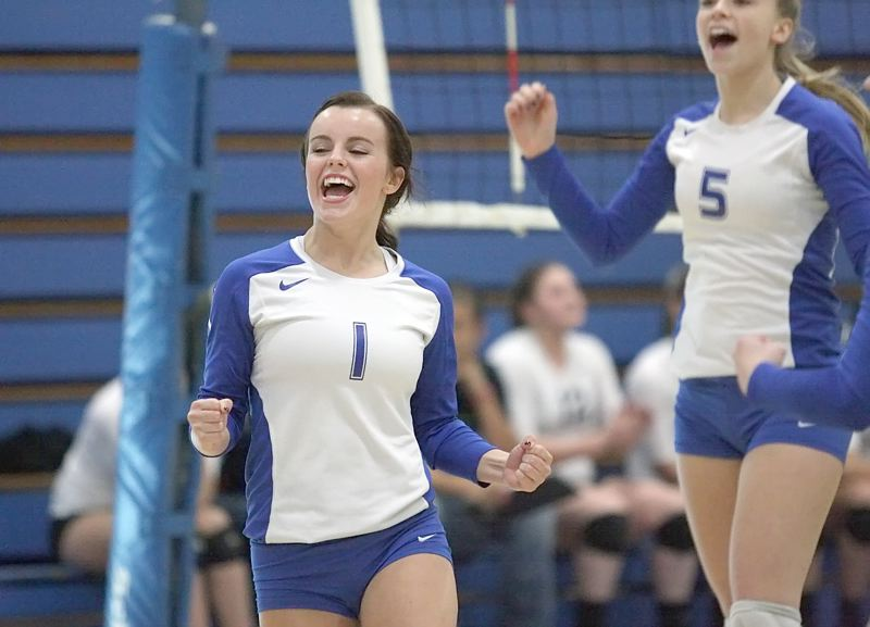 by: MILES VANCE - SCORE FOR US - Ellie Parker of Aloha celebrates a point during her teams Saturday loss to Crater in the Class 6A Play-In round at Aloha High School.