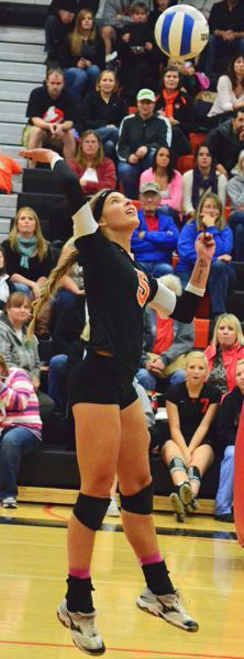 by: JOHN BREWINGTON - Scappoose's Lexine Loos goes up for a hit during one of the Tribe's two matches with Astoria last week. Scappoose finished third in the  Cowapa League and advanced to state with a play-in win at Baker.