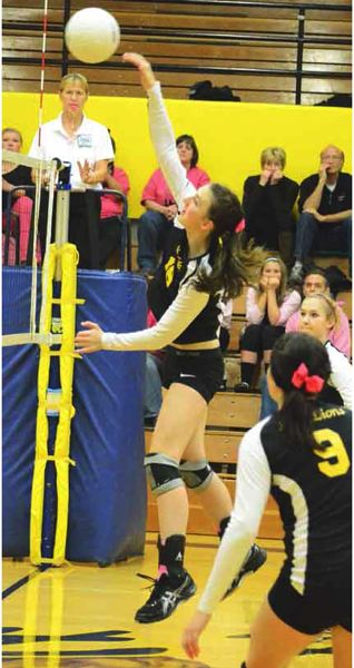 by: JOHN BREWINGTON - St. Helens' Taylor Albertson hits a ball during last week's game with Liberty.
