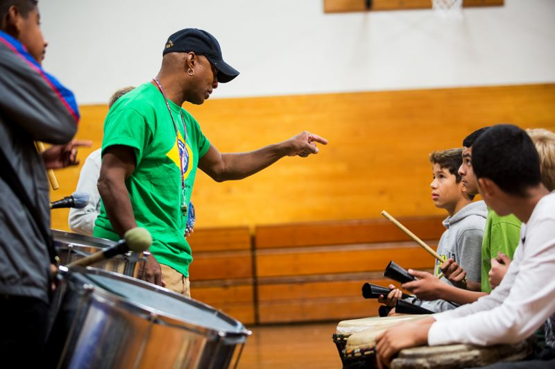 by: TRIBUNE PHOTO: CHRISTOPHER ONSTOTT - Faubion School African-Brazilian instructor Chuk Barber stops his class, pointing out students for not keeping the correct rhythm.