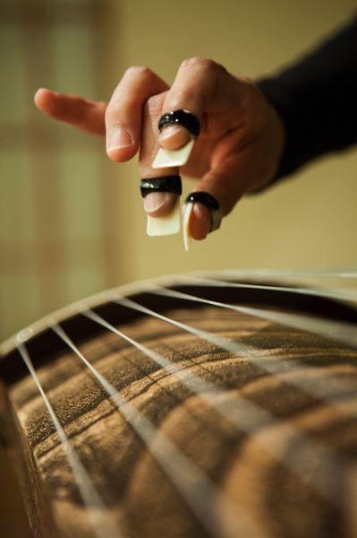 by: TRIBUNE PHOTO: CHRISTOPHER ONSTOTT - Because koto players can move bridges beneath strings to reach different scales, Mitsuki Dazai says the music produces a range of clear and crisp to very mellow, deep sounds.