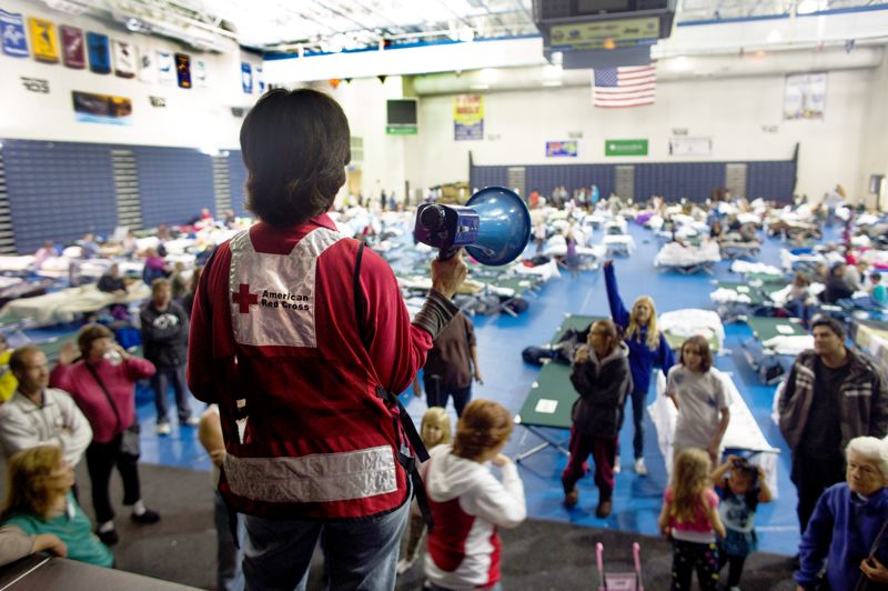 by: CONTRIBUTED PHOTO: LES STONE/AMERICAN RED CROSS - Nancy Barrett, Red Cross volunteer from Nevada, is the manager of the evacuation shelter at Pine Belt Arena in Toms River, N.J. Early Monday afternoon, she called a meeting to update shelter residents on storm conditions and answer their questions.