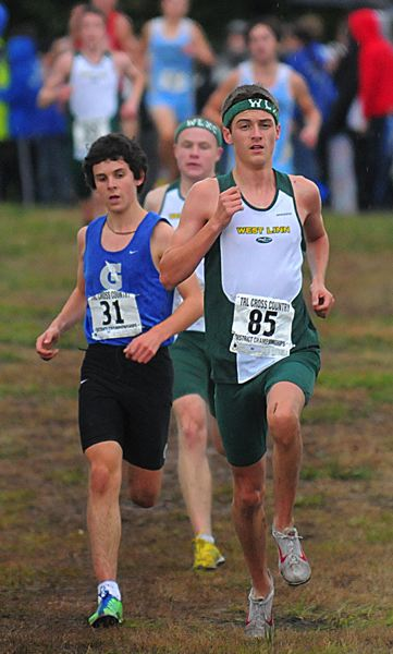 by: VERN UYETAKE - Connor Cushman led the way for West Linn's boys cross country team last week at Clackamas Community College, taking third place individually.