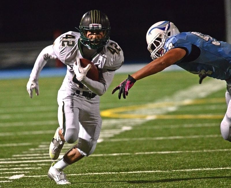 by: VERN UYETAKE - Louie Germain sprints past a Lakeridge defender during last week's game against the Pacers. Germain scored all five of West Linn's touchdowns in the game.