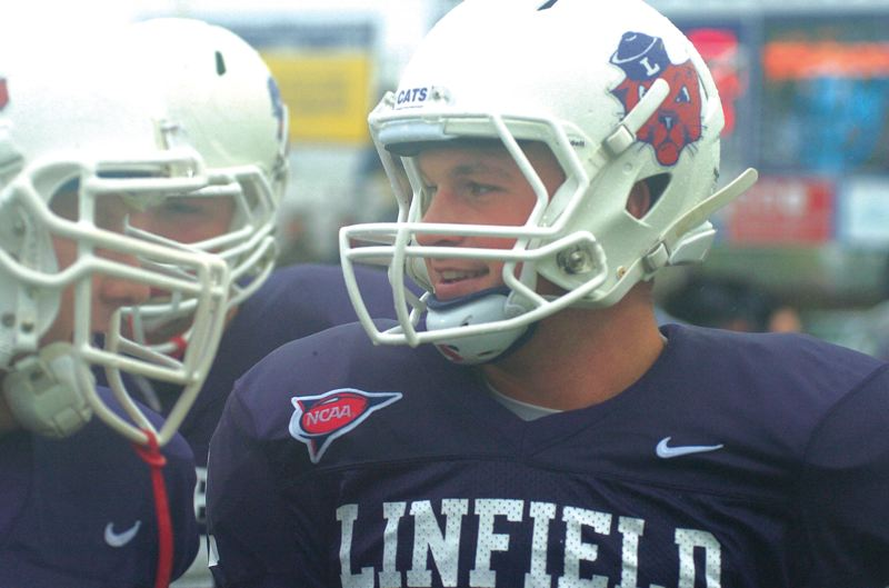 by: THE OUTLOOK: DAVID BALL - Linfield QB Mickey Inns shares a laugh with a teammate after throwing his third TD of the day against Willamette. He is 17-1 as a starter with the Wildcats.