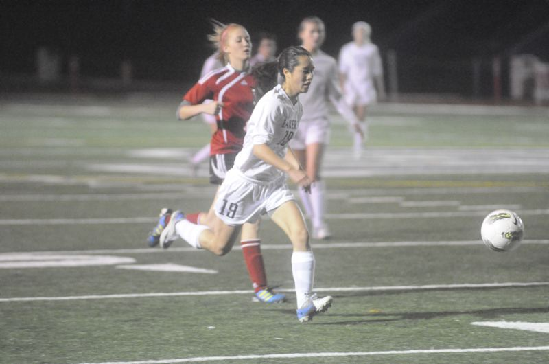 by: MATTHEW SHERMAN - Lake Oswego's Zoe Wong sprints down the sideline during the Lakers' 7-0 win over North Salem on Tuesday.