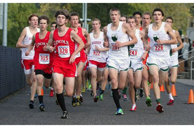 by: PAMPLIN MEDIA GROUP: MILES VANCE - Lincoln's Tanner Smith (328) leads the early pack in the Metro League district cross-country meet at Tualatin Hills on Oct. 24. Smith finished third, qualifying for state. Lincoln's team made it to state, too, placing second behind Jesuit.