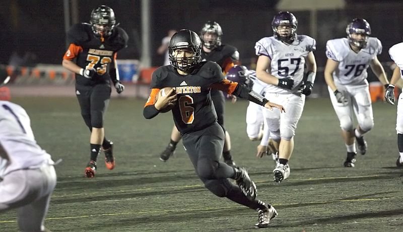 by: MILES VANCE - TD RUN - Beaverton senior quarterback Kyle Eckrosh takes off on a 16-yard touchdown run against South Eugene on Friday night.