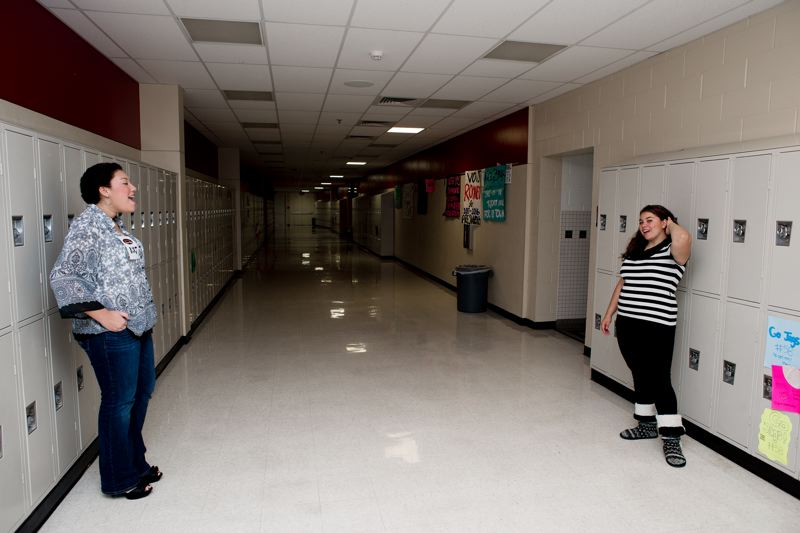 by: TRIBUNE PHOTO: CHASE ALLGOOD -  Taylor Belk (left) and Dareshay Harper practice in the hallways of Century High School for their auditions for Hillsboro Teen Idol. TRIBUNE PHOTO: CHASE ALLGOOD