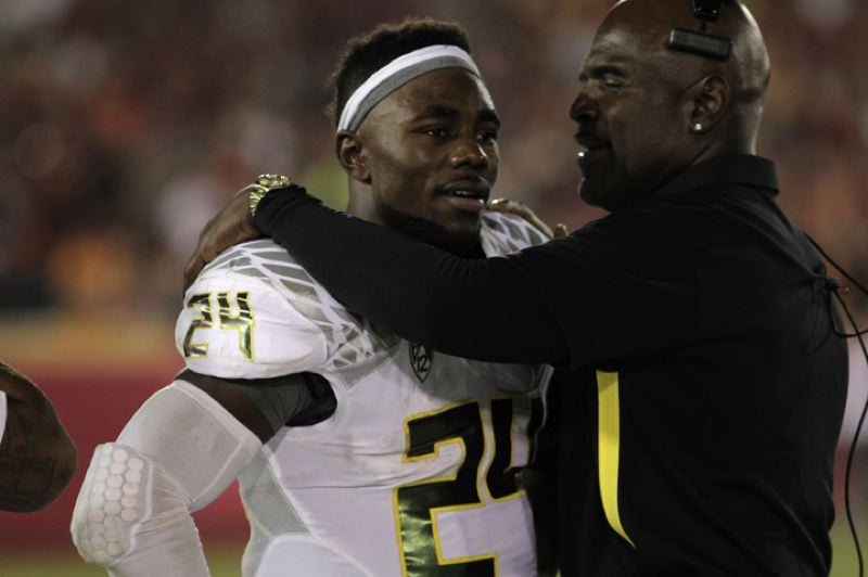 by: TRIBUNE PHOTO: JAIME VALDEZ - Kenjon Barner is greeted on the sidelines by Oregon Ducks running backs coach Gary Campbell during UO's 62-51 win Saturday at USC.