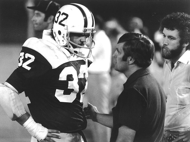 by: COURTESY PHOTO - Former Portland State football coach Mouse Davis talks to one of his players during his stint with the Vikings in the early 1970s.