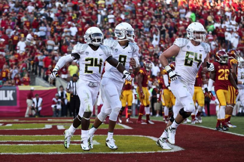 by: TRIBUNE PHOTO: JAIME VALDEZ - Kenjon Barner and the Oregon Ducks celebrate one of his five touchdowns in the 62-51 win Saturday at USC.