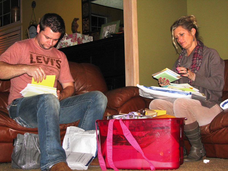 by: OUTLOOK PHOTO/ KRISTOPHER ANDERSON - Clint Heichel and Lorilei Ritmiller read stacks of letters they received since learning of Whitney Heichel's death.