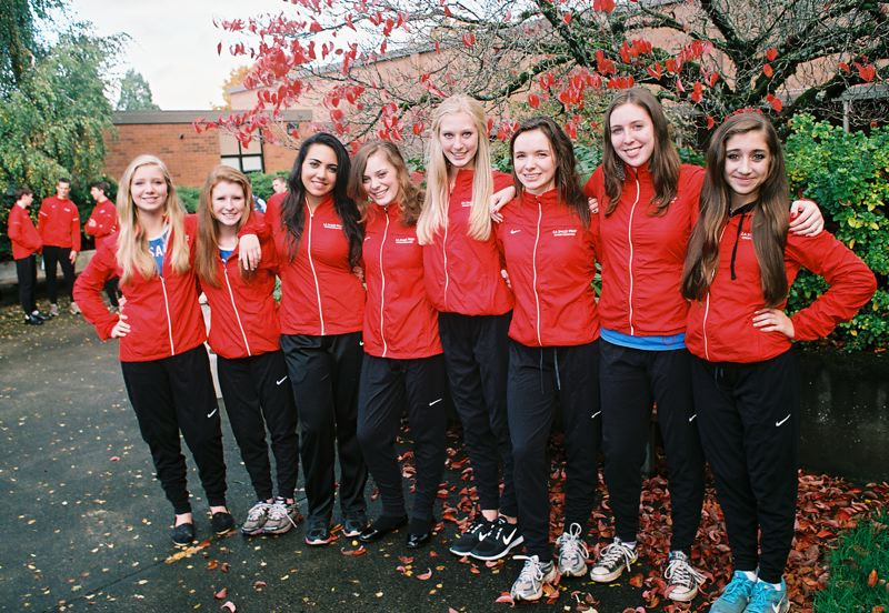 by: JOHN DENNY - The athletes on La Salle Preps girls cross country team have a right to be very proud. They won the first-place team trophy at Saturdays Class 4A State Championship Meet, the first state championship in their sport in school history. Vying for the standout team were: (from left) Noelle Gammon, Hannah Baggs, Nicole Scott, Hannah Hildreth, Olivia Ogard, Kelsey Cathcart, Morgan Toll, Carly Veasy and (not pictured) Madeleine Ogard. There were five seniors on this years team: Scott, Hildreth, Cathcart, Toll and Madeleine Ogard.