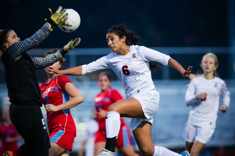 by: CHRISTOPHER ONSTOTT - Senior Claudia Flores (6) and her teammates kept the pressure on South Salems goalie all game long in Saturdays state playoff win over the Saxons.