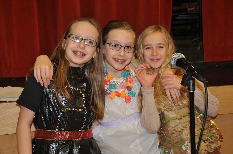 by: MICHAEL QUISLING - Trashion Fashion Show emcees, from left, fifth-graders Ashley and Briana Alexander and Ashley Yablonsky.