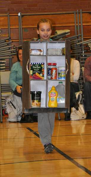 by: MICHAEL QUISLING - One Trashion Fashion Show contestant dressed up as a refrigerator.