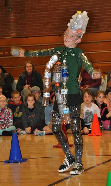 by: MICHAEL QUISLING - Fifth-grader Grant Johnson titled his recycled costume 'Bottle Boy.'