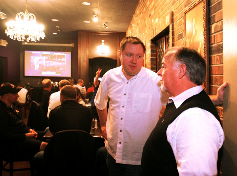 by: OUTLOOK PHOTO: JIM CLARK - Matt Wand talks with John Minnis at Wands election night party, following the initial election results showing Wand losing to opponent Chris Gorsek.