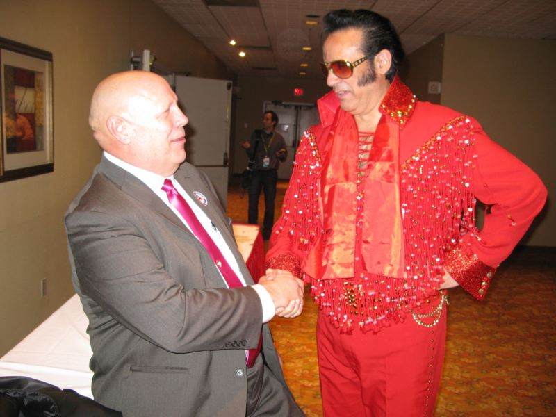 by: RAYMOND RENDLEMAN - Oak Grove Elvis Ray Herrera congratulates John Ludlow after his victory became apparent in the Nov. 6 election for Clackamas County chairman as Republicans celebrated on election night at the Monarch Hotel in Clackamas.