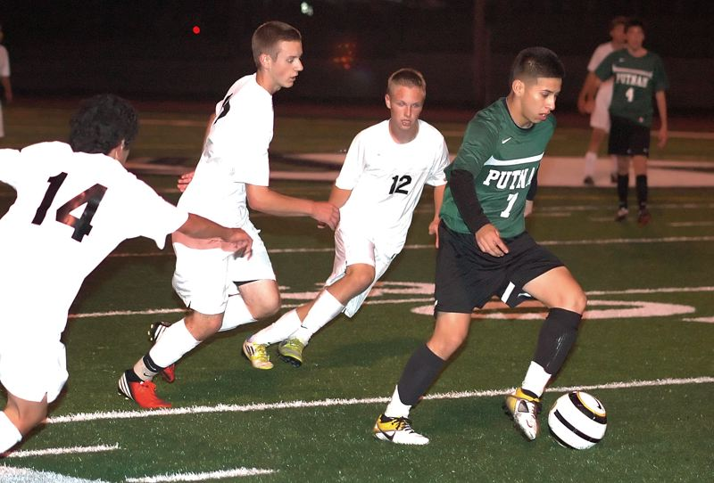 by: KRISTOPHER ANDERSON - The Sandy Pioneers boys soccer team upset the No. 12 Willamette Wolverines 1-0 last Saturday in the play-in round at Willamette High School.