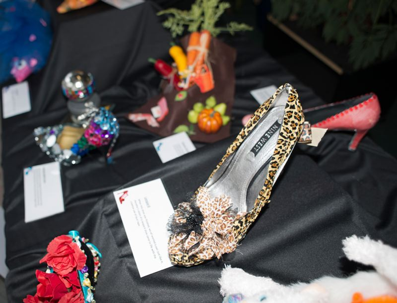 by: NEWS-TIMES PHOTO / CHASE ALLGOOD - A closet-full of beautiful shoes, reimagined as canvasses for art by local dementia patients, are on display through November at the News-Times office this month.