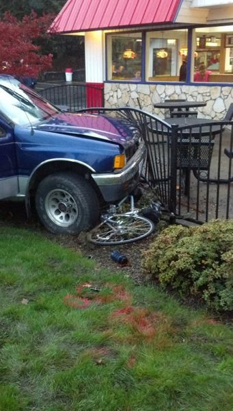 by: COURTESY PHOTO - A bicycle struck by a truck traveling on Highway 26 was carried under the vehicle until the truck crashed into a fence at the Manning Dairy Queen Saturday.