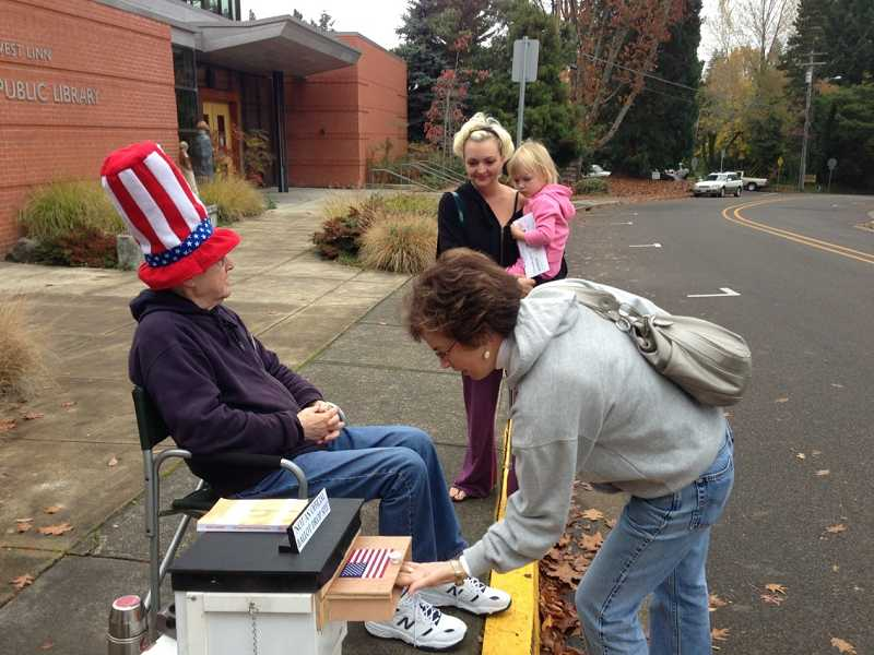 by: LORI HALL - Several residents entrusted their ballots to Alan Lewis on Tuesday morning. Lewis collected 313 ballots prior to the library opening.