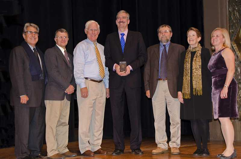 by: SUBMITTED PHOTO - The National Preservation Award is presented to Lake Oswego City Councilor Jeff Gudman. Also participating are, from left, Jorge Hernandez, vice chair of the National Trust Board of Trustees; Gary Vonada (Pioneer Waterproofing Company), construction supervisor; Tom Fowler (Miller Consulting Engineers, Inc.), project engineer; Councilor Jeff Gudman; Rick Minor (Heritage Research Associates), project archaeologist; Susanna Kuo (Furnace Restoration Task Force), historical consultant; Stephanie Meeks, president of the National Trust for Historic Preservation.