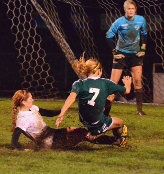 by: JOHN BREWINGTON - St. Helens' Stevie S'rawn got a yellow card for taking out Putnam's Rachel Baker on this play. The Lions lost to Putnam, 2-0.