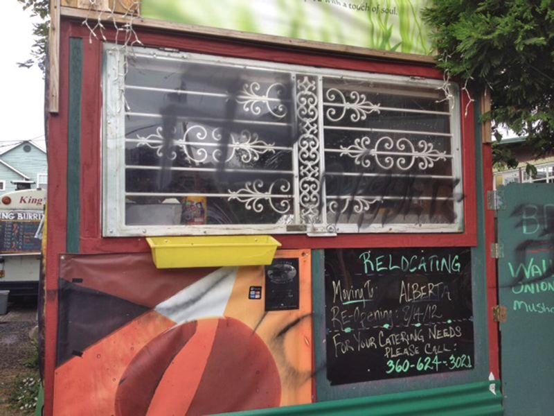 by: TRIBUNE PHOTO: CHRISTOPHER ONSTOTT  - Food cart operator Ellis Bradley has been thinking of a move from Portland since swastikas and racial slurs were spray painted on his cart in August.