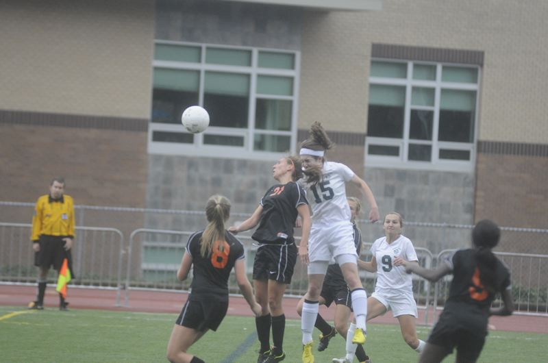 by: MATTHEW SHERMAN - Madison Leek connects on a header for West Linn's second goal, knocking the ball in on a corner kick off the foot of Paige Myers in the team's 6-0 win over Roseburg.