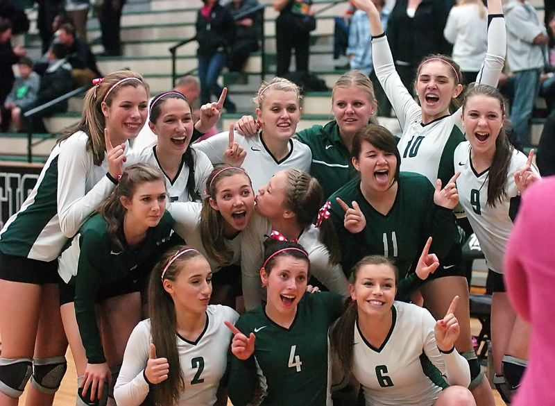 by: DAN BROOD - HAPPY WINNERS -- The Tigard High School volleyball team celebrates following its state playoff win over Grant.