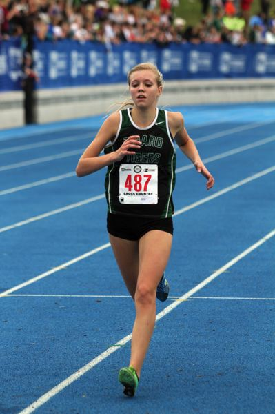 by: JONATHAN HOUSE - ALMOST DONE -- Tigard sophomore Elizabeth Dean nears the finish line at Saturday's state championships.