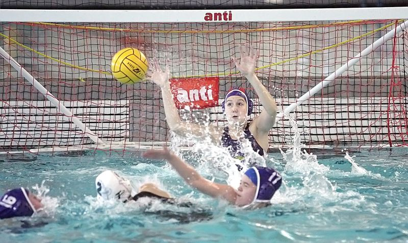 by: MILES VANCE - GOT IT - Sunset goalie Abby Griffiths  reaches to make a save during her team's state playoff game against Tigard on Saturday at Osborn Aquatic Center.