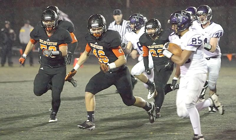 by: MILES VANCE - FOR THE DEFENSE - Beaverton's (right to left) Dylan Erice, Greg Marshall and John Ahn chase down a South Eugene ballcarrier during their team's Friday victory.