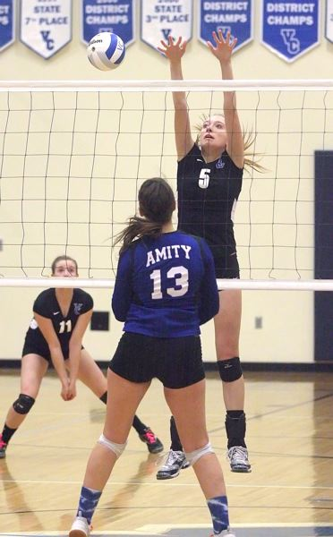 by: MILES VANCE - ON THE BALL - Valley Catholic's Rachel Liening goes up to make a block against Amity during her team's three-game sweep of the Warriors at Valley Catholic High School in the first round of the Class 3A state playoffs on Saturday.