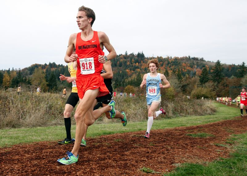 by: JONATHAN HOUSE - MAKING TRACKS - Beaverton senior Dan Oekerman races to a second-place finish at the Class 6A state cross country meet on Saturday at Lane Community College in Eugene.