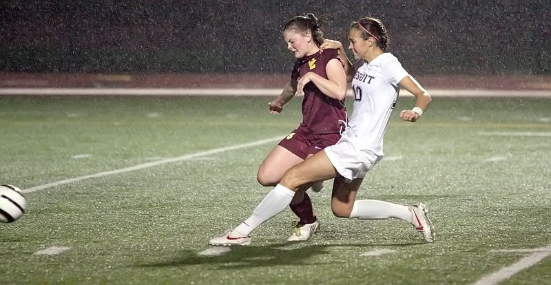 by: MILES VANCE - ON THE RUN - Jesuit junior Molly Petrusich beats Sarah Lance tof Central Catholic o the ball during the Crusaders 3-0 home win in the second round of the Class 6A state playoffs on Tuesday.