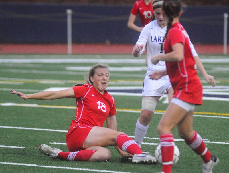 by: MATT SHERMAN - TACKLE FOOTBALL - Westview's Erika Cook makes a sliding tackle in the Wildcats' 1-0 win over Lake Oswego last week